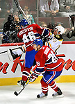 24 September 2009: Montreal Canadiens' right wing forward Andrei Kostitsyn checks Boston Bruins right wing forward Michael Ryder into the boards at the Bell Centre in Montreal, Quebec, Canada. The Bruins edged out the Canadiens 2-1in a pre-season overtime shootout. Mandatory Credit: Ed Wolfstein Photo