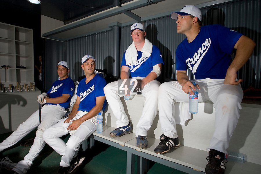 20 August 2007: From left to right, Boris Marche, Coach Sylvain Virey, David Gauthier and Vincent Ferreira rest in the dugout prior to the Czech Republic 6-1 victory over France in the Good Luck Beijing International baseball tournament (olympic test event) at the Wukesong Baseball Field in Beijing, China.