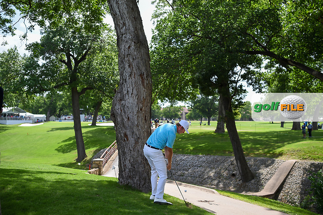 Brandt Snedeker (USA) hits his approach shot on from behind a treen on 10 during round 1 of the 2019 Charles Schwab Challenge, Colonial Country Club, Ft. Worth, Texas,  USA. 5/23/2019.<br /> Picture: Golffile | Ken Murray<br /> <br /> All photo usage must carry mandatory copyright credit (© Golffile | Ken Murray)