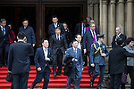 © Joel Goodman - 07973 332324 . 23/10/2015 . Manchester , UK . Chinese delegates pour out of Manchester Town Hall , in Albert Square , as Chinese president , Xi Jinping , visits inside as part of his state visit to the United Kingdom . Photo credit : Joel Goodman