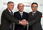 """July 21, 2016, Tokyo, Japan - Japan's insurer Sumitomo Life Insurance president Masahiro Hashimoto (C) shakes hands with South African insurer Discovery Ltd. Chief executive Adrian Gore (L) and Japanese communication giant Softbank president Ken Miyauchi (R) as they announced Sumitomo will develop the new insurance product """"Japan Vitality Project"""" with other two companies at a press conference in Tokyo on Thursday, July 21, 2016. The new life insurance has lower premiums to more healthy conscious people using health care devices or smartphones with health care applications.     (Photo by Yoshio Tsunoda/AFLO) LWX -ytd-"""
