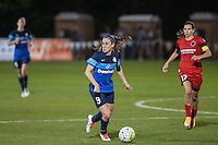Kansas City, Mo. - Saturday April 23, 2016: FC Kansas City midfielder Heather O'Reilly (9) brings the ball up the pitch during a match against Portland Thorns FC at Swope Soccer Village. The match ended in a 1-1 draw.
