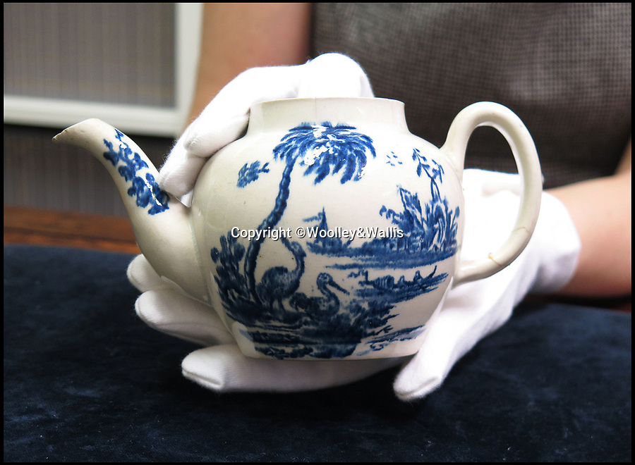 BNPS.co.uk (01202 558833)Pic: Woolley&Wallis/BNPS<br /> <br /> Storm over a broken teapot...<br /> <br /> A bargain-hunter is celebrating after a porcelain teapot he bought on a whim for £15 turned out to be the first one ever made in America and has sold for an incredible £575,000.<br /> <br /> The broken pot, missing its lid, was produced by John Bartlam, a British potter who took his trade across the Atlantic to America in the mid-18th century.<br /> <br /> But Bartlam's enterprise was interrupted by the American Revolution and he rapidly returned to the UK. Hardly any examples of his American  work exist today.<br /> <br /> Due to a great deal of US interest four tea bowl's from the same set made by Bartlam in America sold at auction for £100,000 in 2013. <br /> <br /> It was thought the matching blue and white teapot could sell for a similar sum, but due to storm of interest the hammer eventually came down, very carefully, at a whopping £575,000<br /> <br /> It's thought the prestigious Metropolitan  Museum of Art in New York topped the bidding.