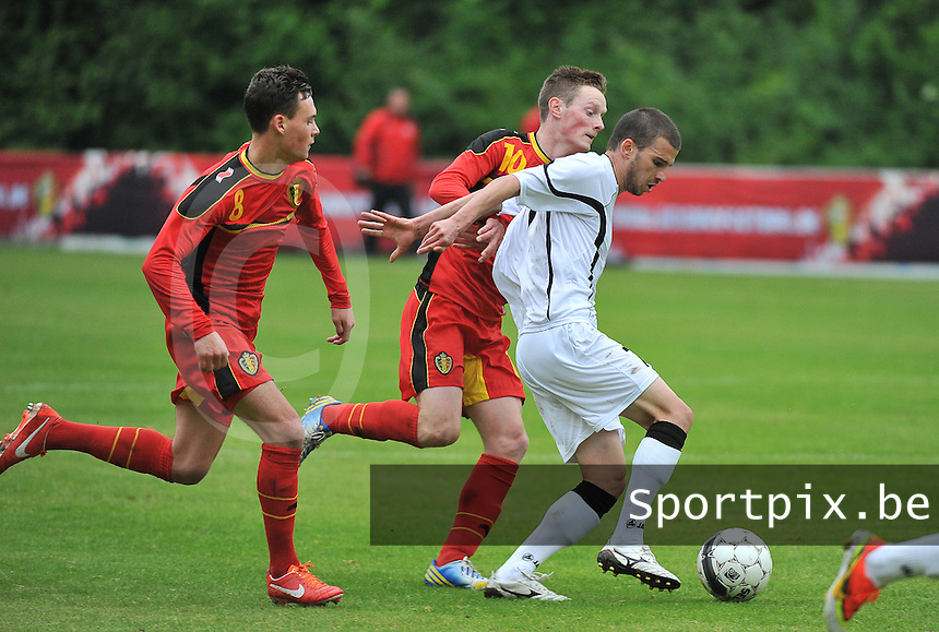 Georgia U19 - Belgium U19 : Guram Samushia (7) and Birger Verstraete (8) with Rob Schoofs (behind)<br /> foto DAVID CATRY / Nikonpro.be