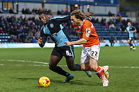 Aaron Pierre of Wycombe Wanderers and Craig Mackail-Smith of Luton Town during the Sky Bet League 2 match between Wycombe Wanderers and Luton Town at Adams Park, High Wycombe, England on 6 February 2016. Photo by David Horn.