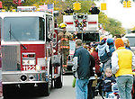 Sentinel/Dan Irving.Firefighters from several area departments parade their trucks through downtown Holland Saturday during the annual Fire Truck Parade..(10/8/05)