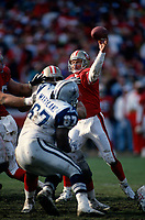 SAN FRANCISCO, CA:  Quarterback Steve Young of the San Francisco 49ers throws a pass during the NFC Championship game against the Dallas Cowboys at Candlestick Park in San Francisco, California on January 15, 1995. (Photo by Brad Mangin)