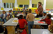 MR / Schenectady, NY. Yates Arts in Education Magnet School, Grade 2.Arts-Themed Urban Elementary School.Students get settled and teacher gives directions to students for doing in-class art project on fall colors using tissue paper and glue..MR: g2c.© Ellen B. Senisi