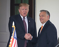 United States President Donald J. Trump, left, shakes hands with Prime Minister Viktor Orban of Hungary, right, as he welcomes him to the White House in Washington, DC on Monday, May 13, 2019.  The two leaders will meet for about an hour. Photo Credit: Ron Sachs/CNP/AdMedia