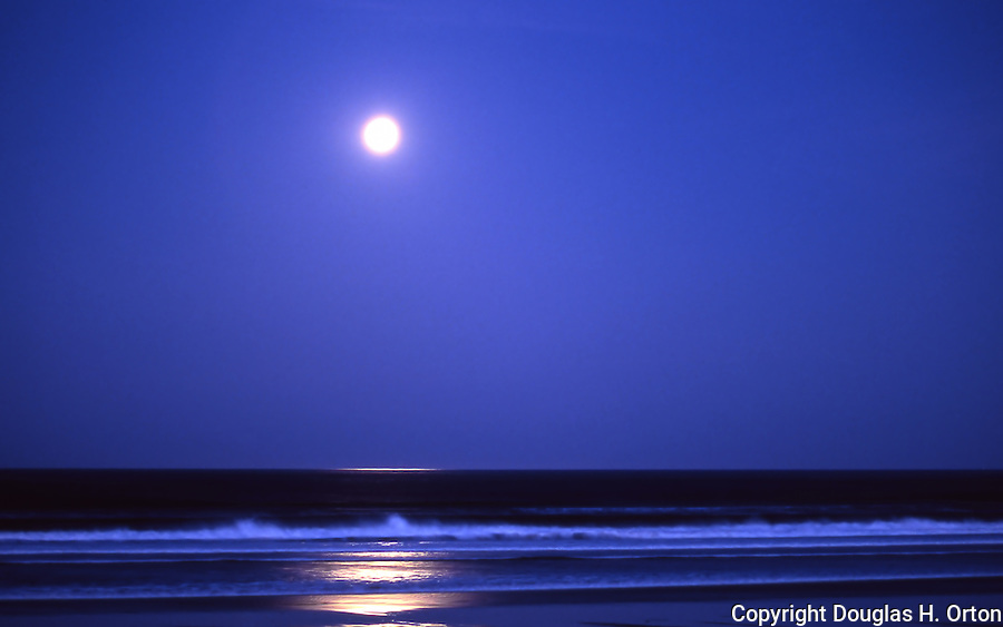 Full moon sets before dawn, Manzanita Beach, Oregon.