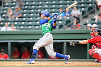 Shortstop Humberto Arteaga (1) of the Lexington Legends bats in a game against the Greenville Drive on Sunday, April 27, 2014, at Fluor Field at the West End in Greenville, South Carolina. The Greenville catcher is Jake Romanski. Greenville won, 21-6. (Tom Priddy/Four Seam Images)