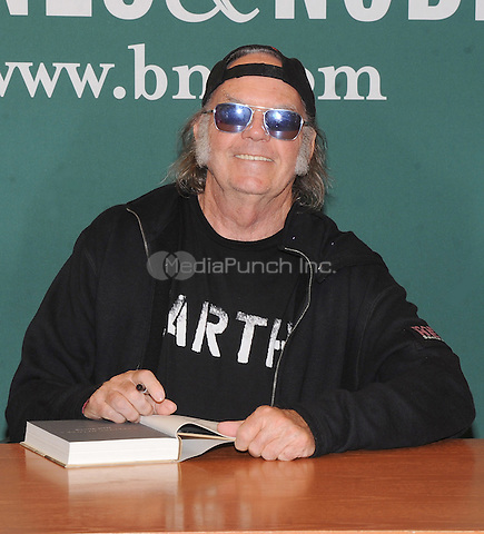 New York, NY- October 14: Neil Young signs copies of his book 'Special Deluxe: A Memoir Of Life And Cars' at Barnes and Noble on October 14, 2014 in New York city. Credit: John Palmer/MediaPunch