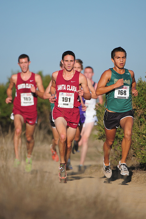 October 29, 2011; Belmont, CA, USA; Santa Clara Broncos runner Robbie Reid (191), San Francisco Dons runner Jose Madera (168) competes during the WCC Cross Country Championships at Crystal Springs.