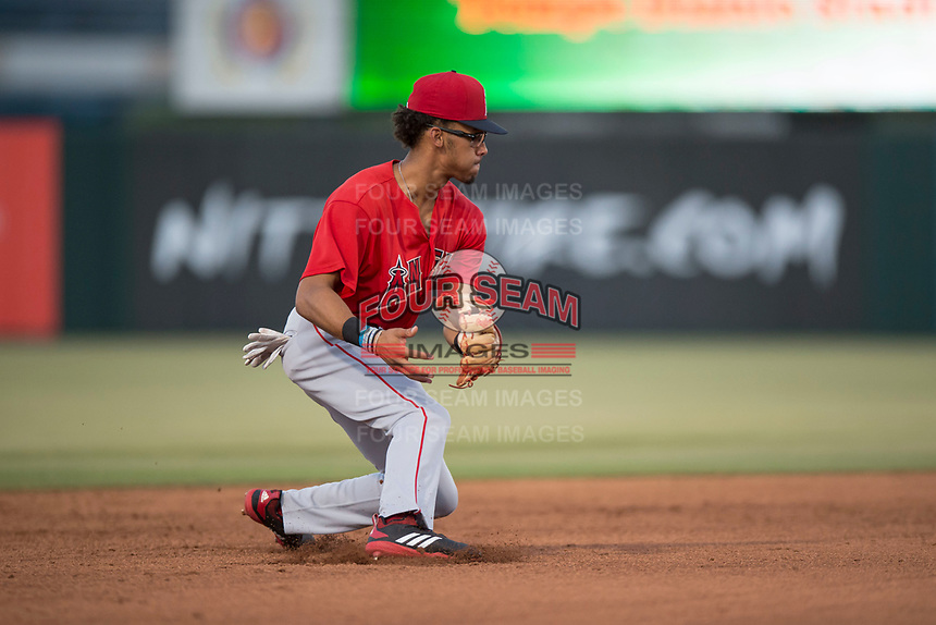 AZL Angels shortstop Jeremiah Jackson (8) fields a ground ball to start a double play during an Arizona League game against the AZL Diamondbacks at Tempe Diablo Stadium on June 27, 2018 in Tempe, Arizona. AZL Angels defeated the AZL Diamondbacks 5-3. (Zachary Lucy/Four Seam Images)