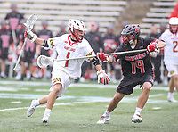 College Park, MD - April 15, 2018: Maryland Terrapins Connor Kelly (1) is being defended by Rutgers Scarlet Knights Garrett Bullett (19) during game between Rutgers and Maryland at  Capital One Field at Maryland Stadium in College Park, MD.  (Photo by Elliott Brown/Media Images International)