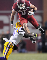 NWA Media/ J.T. Wampler -  Arkansas' A.J. Derby leaps for yards over LSU's Tre'Davious White during the second quarter Saturday Nov. 15, 2014 at Donald W. Reynolds Razorback Stadium.