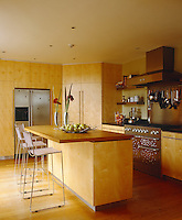 Cherrywood units give the contemporary kitchen a warm feel