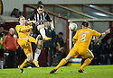 PARS DAVID GRAHAM GETS TO THE BALL AS MOTHERWELL'S NICKY LAW AND STEVEN JENNINGS MAKES A CHALLENGE