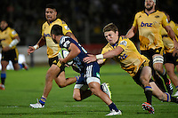 Beauden Barrett in action during the Super Rugby - Hurricanes v Blues at FMG Stadium, Palmerston North, New Zealand on Friday 13 March 2015. <br /> Photo by Masanori Udagawa. <br /> www.photowellington.photoshelter.com.