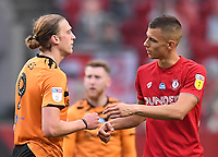8th July 2020; Ashton Gate Stadium, Bristol, England; English Football League Championship Football, Bristol City versus Hull City; Tom Eaves of Hull City and Filip Benkovic of Bristol City bump hands after the match