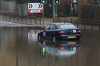 Sheffield Road, Tinsley Sheffield.<br /> Saturday 31st March 2018.<br /> <br /> A Taxi is pictured stuck in Flood Water hours after attempting to travel through. <br /> <br /> Pictures - Alex Roebuck / www.alexroebuck.co.uk