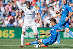 Karim Benzema of Real Madrid (L) fights for the ball with Mauro Wilney Arambarri Rosa of Getafe CF (bottom) during the La Liga 2017-18 match between Getafe CF and Real Madrid at Coliseum Alfonso Perez on 14 October 2017 in Getafe, Spain. Photo by Diego Gonzalez / Power Sport Images