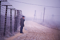 December 10, 1989. Bratislava/Devin, Czechoslovakia. A soldier guarding the Iron Curtain at the border to Austria. (Photo Heimo Aga)