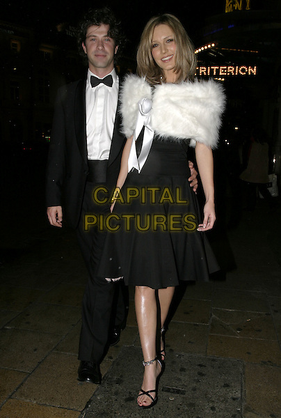EMMA NOBLE.Leaving party at The Critterion, London, .November 8th 2004..full length white fur cape wrap stole black dress.Ref: AH.www.capitalpictures.com.sales@capitalpictures.com.©Capital Pictures.