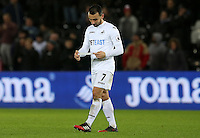 Leon Britton of Swansea City FC plays with his Captains armband as he leaves the field looking dejected following the final whistle of the Premier League match between Swansea City and West Ham United at The Liberty Stadium, Swansea, Wales, UK. 26 December 2016