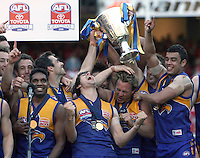 AFL Grand Final. West Coast Eagles v Sydney Swans. Daniel Chick gets whacked over the back off the head with the Premiership cup during the celebrations.