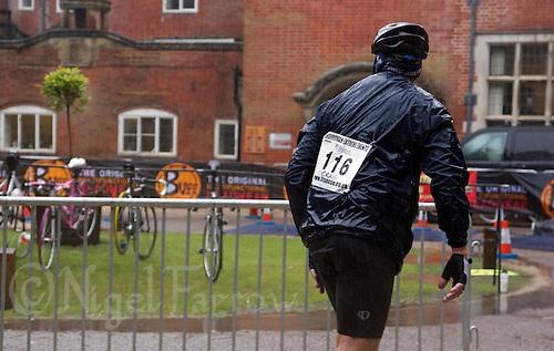 12 JUN 2011 - BRANSGORE, GBR - Enduroman competitor Craig Kircher prepares to go back onto the bike course in the driving rain at the Enduroman Ultra Triathlon Championships .(PHOTO (C) NIGEL FARROW)