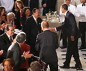 Washington, DC - January 20, 2009 -- United States President Barack Obama greets United States Senator Daniel Inouye (Democrat of Hawaii), at the start of the lunch held in his honor at Statuary Hall in the Capitol  in Washington, Tuesday, Jan. 20, 2009. United States Senator Robert Bird, (Democrat of West Virginia), second from left sitting, had to leave during the lunch for health reasons. .Credit: Lawrence Jackson - Pool via CNP