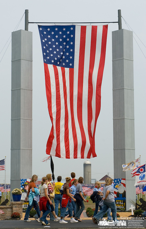 A group of school children walks past a memorial erected on the edge of a field of 3,000 flags installed in a wheat field in Maria Stein, Ohio, Monday, September 11, 2006. The display was erected to honor military, police, fire fighters, and emergency workers on the anniversary of the attacks on the World Trade Center and Pentagon in 2001.<br />