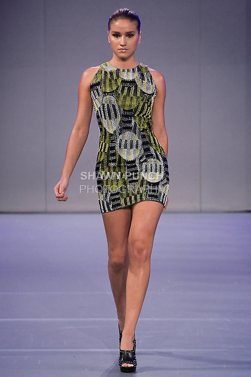 Model walks the runway in an outfit by Eredappa Hart, from the Eredappa Spring Summer 2012, during Couture Fashion Week Spring 2012.
