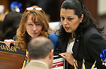 Nevada Assemblywomen Marilyn Kirkpatrick, left, and Olivia Diaz, both D-North Las Vegas, talk with Majority Leader Paul Anderson, R-Las Vegas, on the Assembly floor at the Legislative Building in Carson City, Nev., on Wednesday, April 8, 2015. <br /> Photo by Cathleen Allison