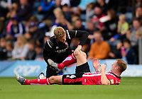 Lincoln City's Michael O'Connor receives treatment from Lincoln City's head of sports science and medicine Mike Hine<br /> <br /> Photographer Andrew Vaughan/CameraSport<br /> <br /> The EFL Sky Bet League One - Wycombe Wanderers v Lincoln City - Saturday 7th September 2019 - Adams Park - Wycombe<br /> <br /> World Copyright © 2019 CameraSport. All rights reserved. 43 Linden Ave. Countesthorpe. Leicester. England. LE8 5PG - Tel: +44 (0) 116 277 4147 - admin@camerasport.com - www.camerasport.com