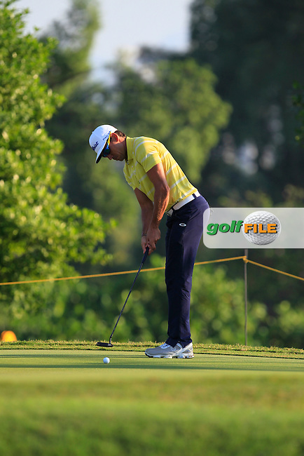 Rafa Cabrera-Bello (ESP) in action during Round Four of the Maybank Championship Malaysia 2016, at the Royal Selangor Golf Club, Kuala Lumpur, Malaysia.  21/02/2016. Picture: Golffile | Thos Caffrey.<br /> <br /> All photos usage must carry mandatory copyright credit (&copy; Golffile | Thos Caffrey).