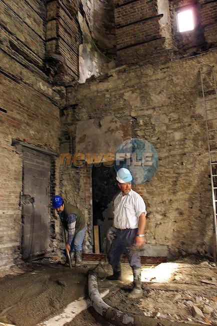 Slane Castle Restoration. Workmen pouring concret in the castle starting to build up the inside.Picture: Fran Caffrey/Newsfile
