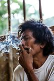 PHILIPPINES, Palawan, Barangay region, Batak man named Arturo Sapitanan smokes in Kalakwasan Village