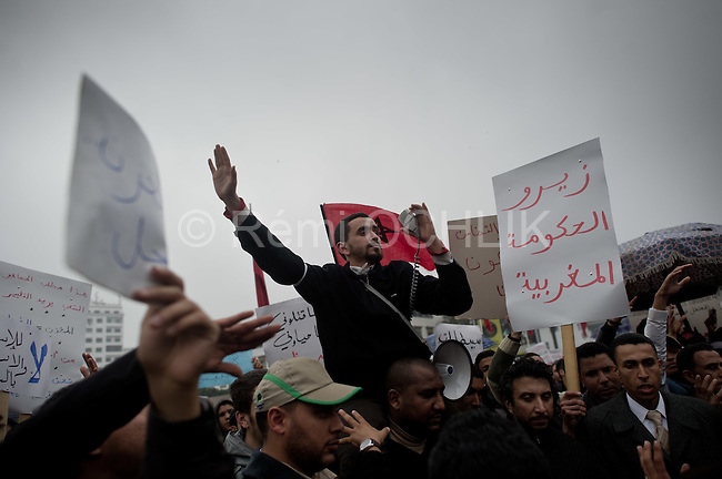 """© Remi OCHLIK/IP3 -  February 20 2011  Casablanca - Morocco -  Thousands of protesters took to the streets in Morocco on Sunday demanding King Mohammed give up some of his powers, dismiss the government and clamp down on corruption. The banner reads: """"No to get money and power at the same time"""""""