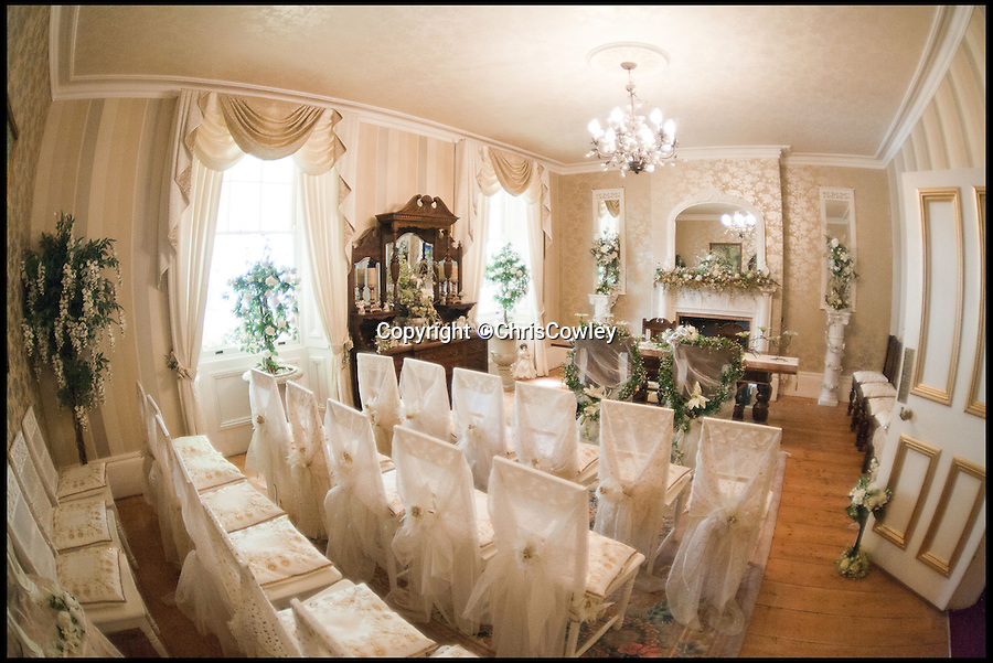 BNPS.co.uk (01202 558833)<br /> Pic: ChrisCowley/EnchantedManor/BNPS<br /> <br /> **Please use full byline**<br /> <br /> A wedding ceremony room.<br /> <br /> Sleeping Beauties and Cinderallas take note - make a wish and this luxury fairytale hotel could be yours for a cool £1.5 million.<br /> <br /> With 11 sumptuous suites - all of which are decked out in fairtytale style with four-poster beds - the Enchanted Manor is the stuff dreams are made of.<br /> <br /> Coupled with idyllic sea views, the unique 5* property near Niton on the Isle of Wight has become a bolthole for couples seeking fairytale romance.<br /> <br /> Once a historic Victorian manor house, owners Ric and Maggie Hilton set about creating their dream come true after saving the grand building from ruin in 2006.<br /> <br /> The property is being on the market for £1.5 million with property guru Sarah Beeny's online estate agents Tepilo.