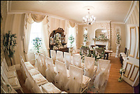 BNPS.co.uk (01202 558833)<br /> Pic: ChrisCowley/EnchantedManor/BNPS<br /> <br /> **Please use full byline**<br /> <br /> A wedding ceremony room.<br /> <br /> Sleeping Beauties and Cinderallas take note - make a wish and this luxury fairytale hotel could be yours for a cool &pound;1.5 million.<br /> <br /> With 11 sumptuous suites - all of which are decked out in fairtytale style with four-poster beds - the Enchanted Manor is the stuff dreams are made of.<br /> <br /> Coupled with idyllic sea views, the unique 5* property near Niton on the Isle of Wight has become a bolthole for couples seeking fairytale romance.<br /> <br /> Once a historic Victorian manor house, owners Ric and Maggie Hilton set about creating their dream come true after saving the grand building from ruin in 2006.<br /> <br /> The property is being on the market for &pound;1.5 million with property guru Sarah Beeny's online estate agents Tepilo.