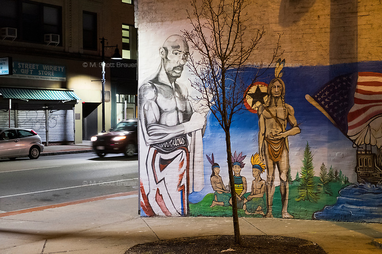 A mural on the side of Tuxedos by Merian depicts a boxer and Native Americans in downtown Brockton, Massachusetts, USA, on Wed., March 29, 2017.