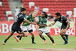 Branco Du Preez of South Africa runs with the ball while New Zealand's players, including Sione Molia (right), try to stop him, during the match South Africa vs New Zealand, Day 2 of the HSBC Singapore Rugby Sevens as part of the World Rugby HSBC World Rugby Sevens Series 2016-17 at the National Stadium on 16 April 2017 in Singapore. Photo by Victor Fraile / Power Sport Images