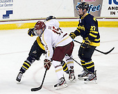 Cam Spiro (BC - 15), Justin Mansfield (Merrimack - 27) - The Boston College Eagles defeated the visiting Merrimack College Warriors 4-3 on Friday, November 16, 2012, at Kelley Rink in Conte Forum in Chestnut Hill, Massachusetts.