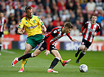 David Brooks of Sheffield Utd fouled by Marco Stiepermann of Norwich City during the Championship match at Bramall Lane Stadium, Sheffield. Picture date 16th September 2017. Picture credit should read: Simon Bellis/Sportimage