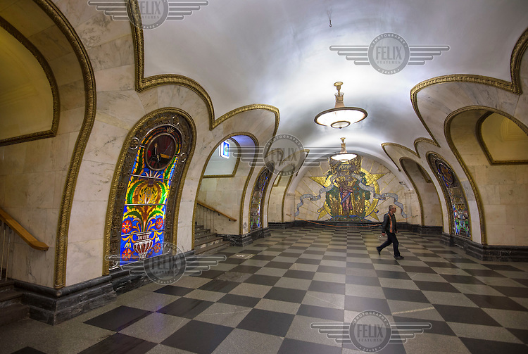 A stained glass panel, one of 32 at Novoslobodskaya Metro Station, which was designed by Pavel Korin. His mosiac 'Peace Throughout the World' is on the far wall.