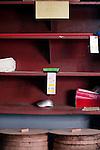 havana, Cuba. Empty shops, tiendas publicas, where  people can have some primary food showing a personal 'libreta de abastecimiento'. rationing store in la habana, cuba.