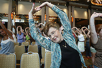 "Southern Arizona Women's Chorus member Sally Micek (SALLY MICEK) stretches at the beginning of a rehearsal at the Grand Hyatt in New York, NY on Friday, June 23, 2006.  The Chorus performed Brusa's ""Missa pro defunctis"" and Beach's ""The Rose of Avontown, Op. 30"" at Carnegie Hall on Sunday night."
