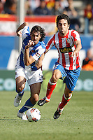 02.05.2012 SPAIN -  La Liga matchday 20th  match played between Atletico de Madrid vs Real Sociedadl (1-1) at Vicente Calderon stadium. The picture show Carlos Martinez Diez (Defender Real Sociedad) and Arda Turan (Turkish midfielder of At. Madrid)